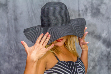 Model with Black Hat