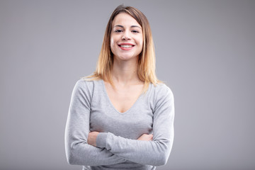 Happy young woman with crossed arms and shirt