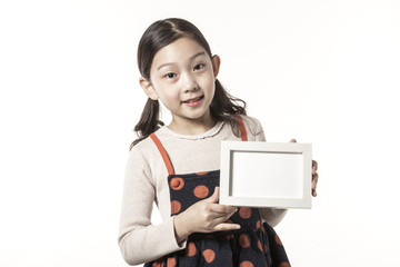 a girl hand hold a empty photo frame isolated white.