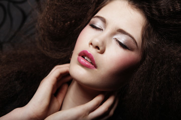 Glamour girl with bright makeup and closed eyes. Beauty female. Perfect skin and make up. Close up.