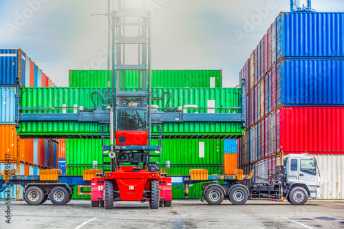 Forklift handling container box loading at the docks with