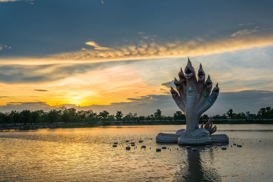 Beautiful Naga statue during sunset