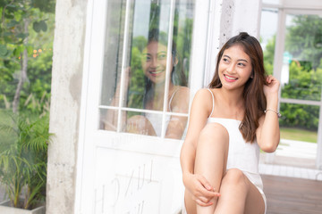 Young beautiful asian woman looking to camera with attractive smiling at home. People lifestyle concept.