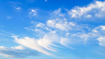 Beautiful swirling clouds in blue sky
