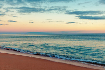 Fototapete - Beautiful seascape, sunset by the ocean, with retro toning, sandy beach