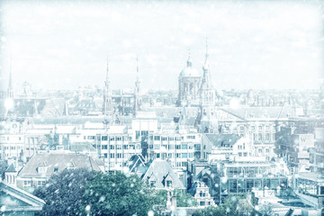 View of Amsterdam with a cloudy sky and snow