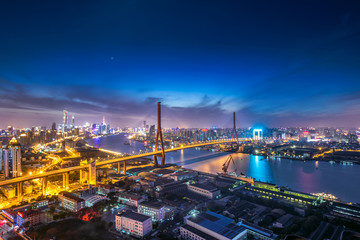Aerial view of modern bridge at night in Shanghai