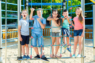 Five  kids posing  at the playground together