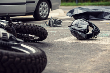 Motorcycle and helmet on the street after dangerous traffic incident