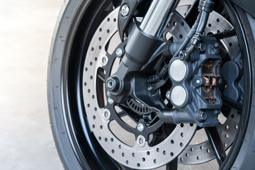 Close up of front radial mount caliper on big bike, Motorcycle with Twin Floating Disk Brake and ABS system on a Sport Bike with copy space.