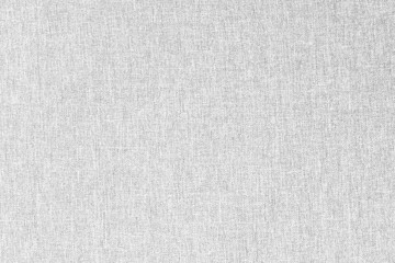 Gray canvas texture for background with visible fibers.