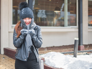 Young Asian women enjoy in snow fall for the first time.Winter young Asia woman portrait on snow winter time.