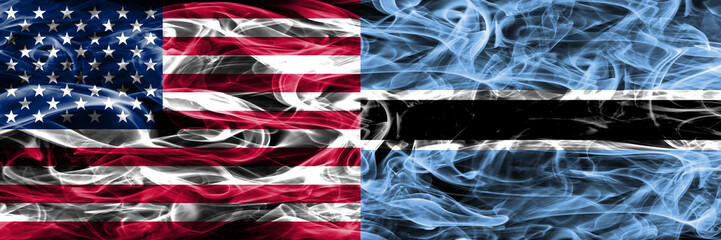 United States vs Botswana smoke flags concept placed side by side