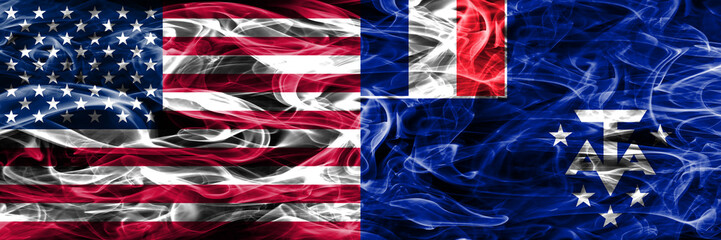 United States vs French Southern and Antarctic Lands smoke flags concept placed side by side