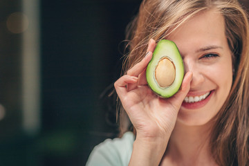 Smiling girl with an avocado