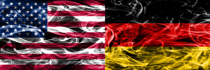 United States vs Germany smoke flags concept placed side by side