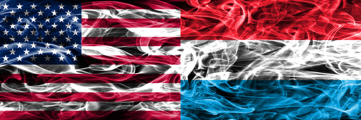 United States vs Luxembourg smoke flags concept placed side by side