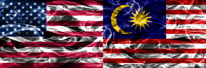 United States vs Malaysia smoke flags concept placed side by side