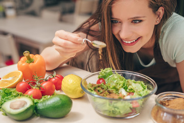 Smiling girl in the kitchen