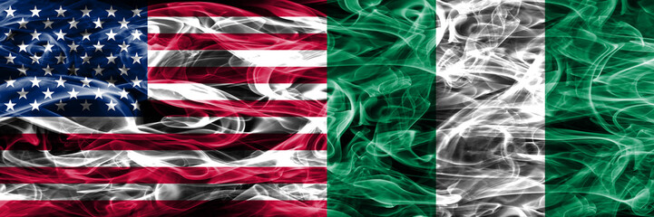 United States vs Nigeria smoke flags concept placed side by side