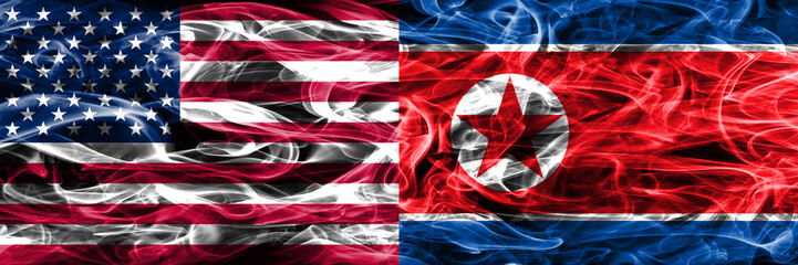 United States vs North Korea smoke flags concept placed side by side