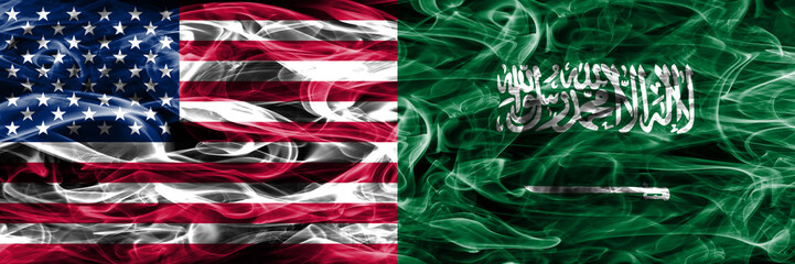 United States vs Saudi Arabia smoke flags concept placed side by side