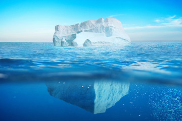 Underwater view of iceberg with beautiful transparent sea. Hidden Danger And Global Warming Concept Fototapete