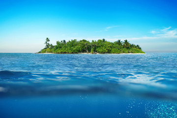 Amazing tropical island in the ocean. Underwater. Bright clear sea water, sunny day, relax travel concept.