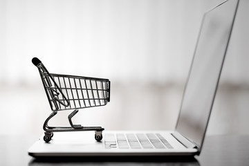 Shopping cart on laptop,online shopping and delivery service concept.