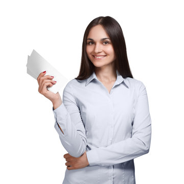 Young woman holding two papers and smiling, isolated on white background