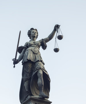 photo of statue of Lady Justice statue in Frankfurt