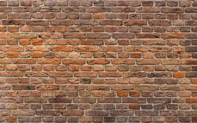 Brick Wall Background. Uneven Brick Texture.