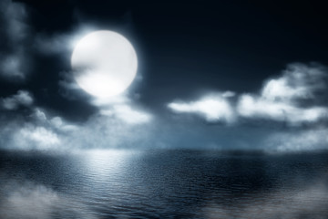 Misty lake at night with moonlight background
