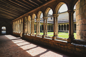 Cloisters around a central courtyard, St Emilion