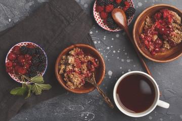 Breakfast with coffee and crumble pie, dark background, healthy vegan breakfast concept.