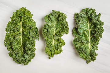 Leaves of kale on a white background. Top view, copy space.
