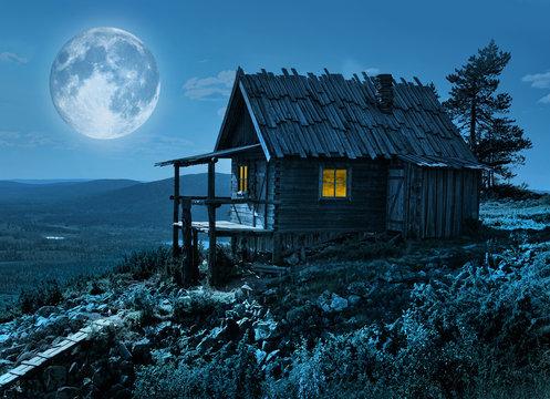 Santa's secret cottage in magic moonlight