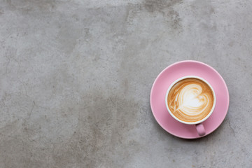 Cappuccino on a concrete surface