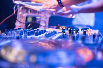 Dj mixes the track in the nightclub at party, hand playing music at turntable on party