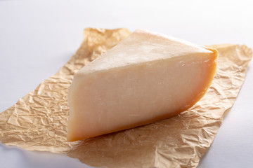 Dutch old Amsterdam  cheese, made from  goat milk on white background