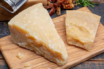 Traditional italian food - 36 months aged in caves Italian parmesan hard cheese from Parmigiano-Reggiano, Italy