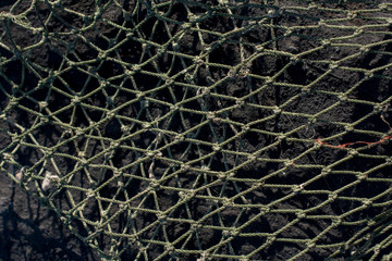 Fishing net  on a rock as background texture