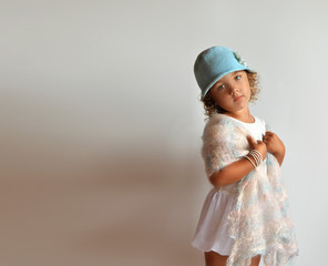 Children's fashion. A little girl in a stylish outfit.