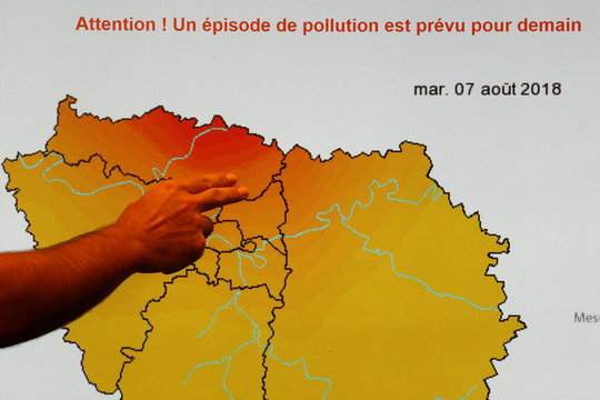 A forecaster for Airparif, the organisation responsible for monitoring the air quality in the Paris agglomeration, points to a map which predicts areas on Tuesday expected to be hit by high levels of pollution, brought about by continued summer temperature