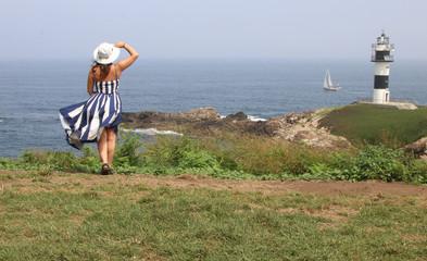 Women travellers. Lighthouse. Isla Pancha. Island. Ribadeo. Galicia. Spain. España. Mar