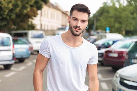 portrait of young casual man standing in a street