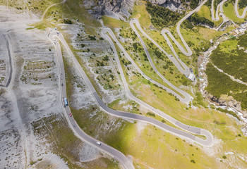 Road to the Stelvio mountain pass in Italy. Up and down amazing aerial view of the mountain bends creating beautiful shapes