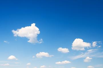 white clouds in  bright blue sky