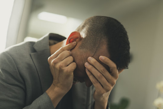 suffering man with his hands in his head
