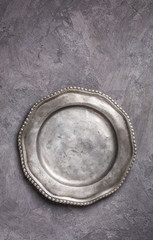 Vintage metal plate on gray plasterd background above